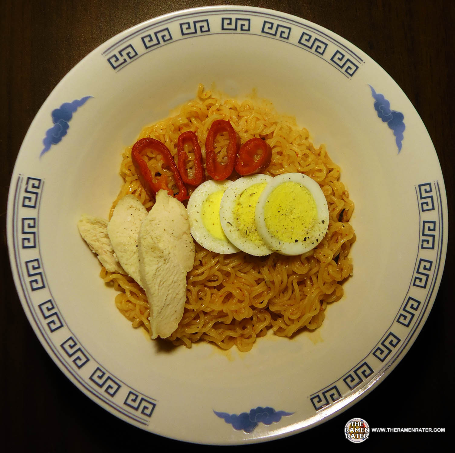Finished (click image to enlarge). Added some chicken, Fresno chile peppers, a hard boiled egg and some Krazy Mixed Up Salt. Noodles are nice and are indeed ...